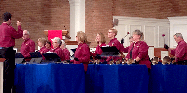 Handbell players performing.
